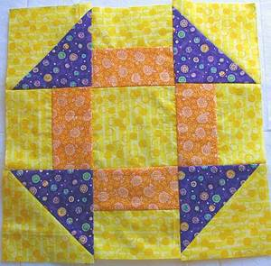 quiltblock-churndash-12in.jpg